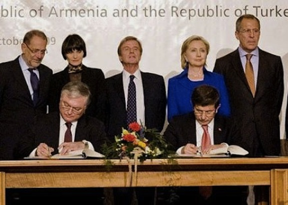 Armenia's Foreign Minister Eduard Nalbandian and then Turkish Foreign Minister Ahmet Davutoglu sign the protocols in Switzerland on Oct. 10, 2010