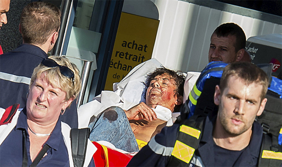 Moogalian being rushed to the hospital following the attack (Photo: The Telegraph)