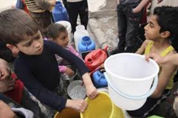 Children receiving water after section of Aleppo were liberated by the Syrian army