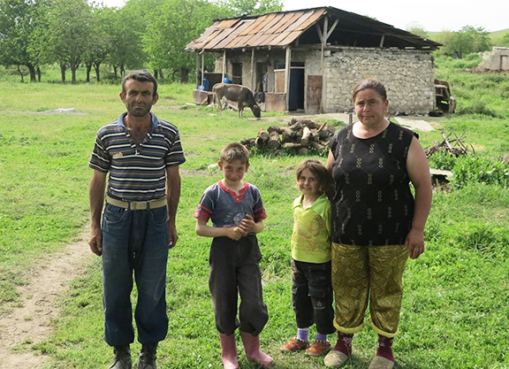 The Piryan family in front of their house (which they share with another family). The family lives close to Govshatly minefield.