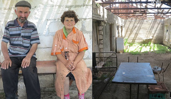 """Vladimir Ghulyan and his daughter Zana. They live in the """"house"""" shown to the right and they also live next to Govshatly minefield"""