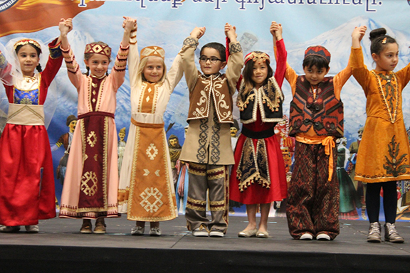 Young students in traditional Armenian garb show off their Armenian dances