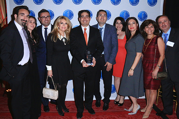 Honoree Vicken Sepilian, MD, center, receives congratulations from Armenian Medical Society members