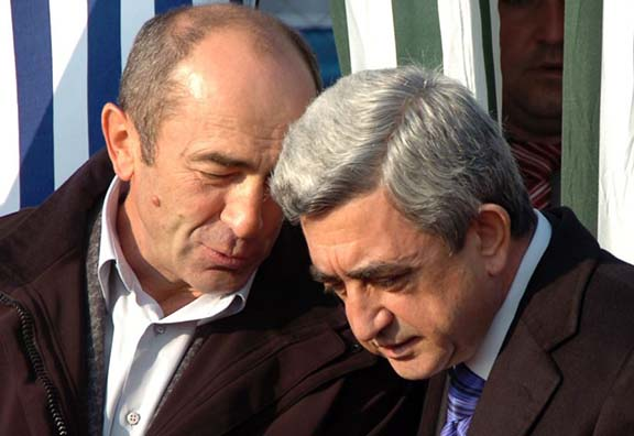 Former president Robert Kocharian (left) with current president Serzh Sarkisian (right) at an official ceremony outside Yerevan in 2008 (Source: Photolure)