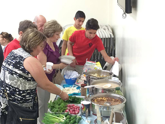 """Guests enjoy breakfast courtesy of the AYF South Valley """"Simon Vratsian"""" chapter and generous donations from local businesses."""