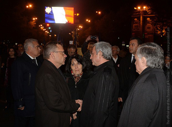French Ambassador to Armenia, Jean-Francois Charpentier (left) is greeted by President Serzh Sarkisian (right) at a vigil held in Yerevan on Saturday (Source: President.am)