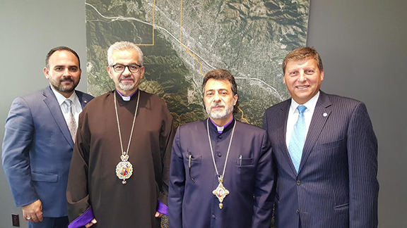 from right to left.  Glendale City Manager Scott Ochoa, Western Prelate  Archbishop Moushegh Mardirossian, Western Primate Archbishop Hovnan Derderian, Glendale City Mayor Ara Najarian AAM governing Board Co-Chairs pause for a photo with Glendale City Officials following the meeting.