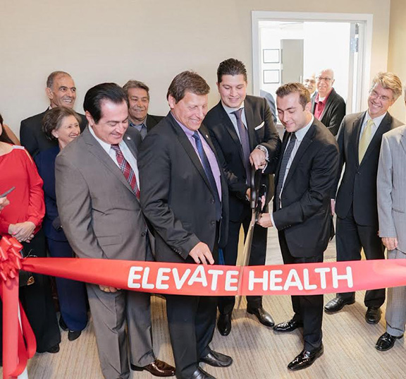 Glendale City Councilman Vartan Gharpetian, Glendale Mayor Ara Najarian and principals of Elevate Group cut the ribbon to the new facility