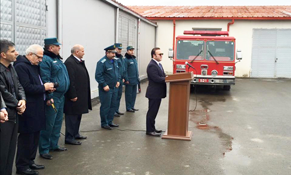 Montebello Mayor Jack Hadjinian addresses the gathering during a ceremony to present a fire truck donated by the City of Montebello