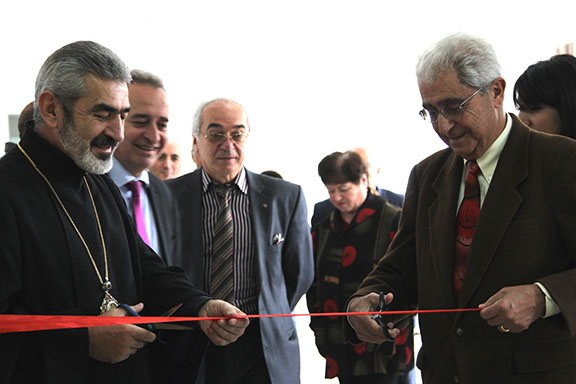 Red ribbon-cutting ceremony at the opening of the TRDP Vayots Dzor office; from left to right, AUA's Dr. Haroutune Armenian and Mr. Ashot Ghazaryan, Vayots Dzor local official, Mr. Gagik Gevorgyan, and his Holiness Abraham Mkrtchyan