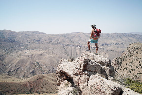 Roffi overlooking a valley after reaching the highest peak of the hot dry, southern region of Armenia