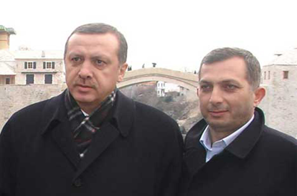 Turkish President Recep Tayyip Erdogan (left) with Metin Kulunk who reportedly funded a bike gang to violently protest Germany Armenian Genocide recognition