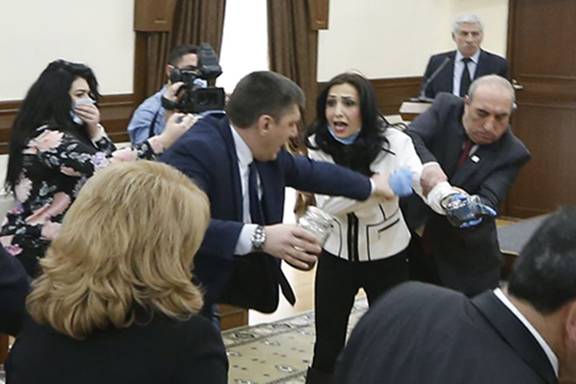 Yerkir Tsirani's Marina Khachatryan is being pulled and shoved during the Yerevan City Council meeting on Tuesday