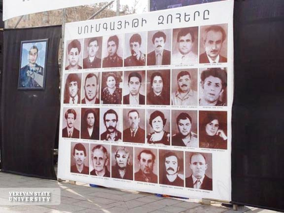 A display featuring photos of Sumgait Pogrim victims in Yerevan