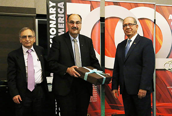Dr. Nazareth Darakjian, President of AMAA Board (left) and Zaven Khanjian Executive Director/CEO of AMAA Present a special appreciation gift to Rev. Dr. Krikor Youmshajekian, President/CEO of AMA-Australia