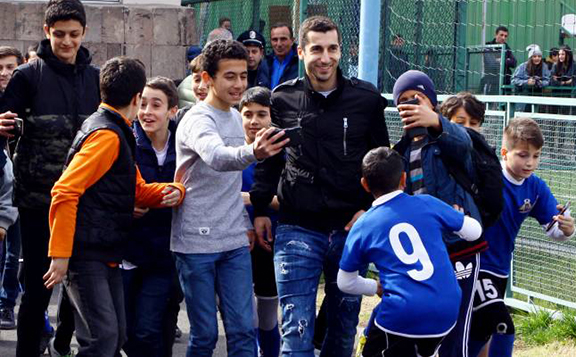 Herikh Mkhitaryan was swamped by fans when he attended a Armenian National Soccer Championship match in Yerevan on Sunday (Photo by Stepan Kocharyan for Armenpress)