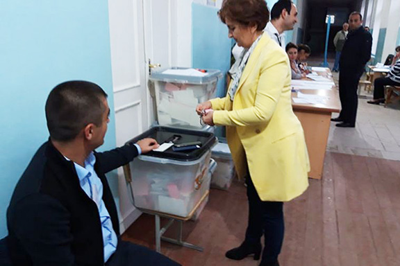 A voter casts her ballot during Sunday's local government elections in Artsakh