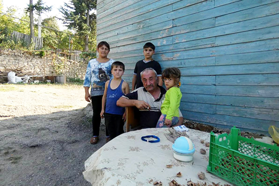 The Hakobyan family in the yard of their new home