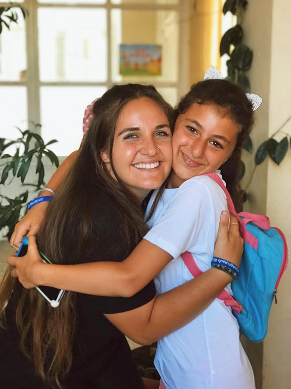 Hanna Mansour with a camper
