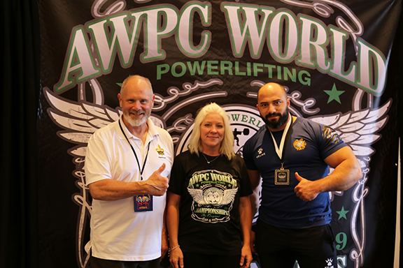 AWPC World Powerlifting Championship 2019, from l to r: President of WPC Mike Sweeney, Secretary of WPC Amy Jackson, Vachagan Baghdagyulyan