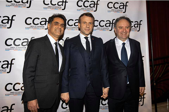 President Emanuel Macron flanked by CCAF co-chairs Mourad Papazian (left) and Ara Toranian.