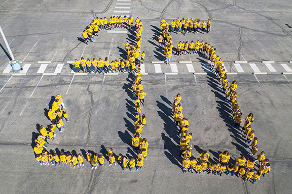 ASA students and faculty stand together to form the number 35 to mark their school's anniversary