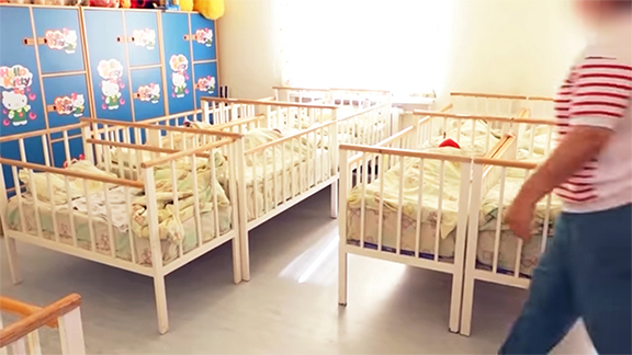 A screenshot of a video announcing the start of an investigation into an organized crime ring accused of selling babies, released by Armenia's National Security Service