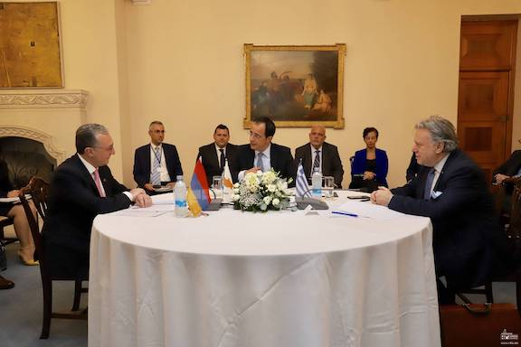 From left, foreign minister of Armenia, Greece and Cyprus Zohrab Mnatsakanyan, Giorgos Katrougalos, and Nikos Christodoulides during a meeting in June 2019