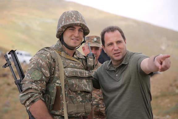 Defense Minister Davit Tonoyan with an Armed Forces soldier