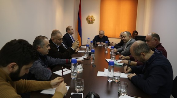 National Salvation Movement's candidate for prime minister, Vazgen Manukyan, meets with policy experts on Jan. 29