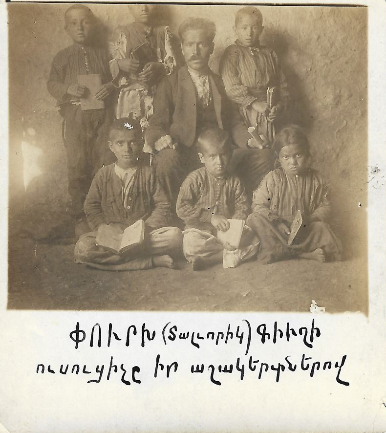 Photograph from the turn of the 20th century of an Armenian teacher in Dalvorig (Sassoun) with his students
