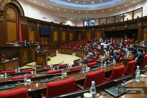 """Acting Prime Minister Nikol Pashinyan addresses a session of parliament on May 10, before """"not being elected,"""" which set in motion June 20 snap elections"""