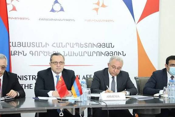 Avet Adonts (second from left) is Armenia's Deputy Foreign Minister during talks with China on May 26