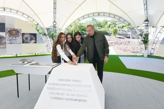"""Azerbaijani President Ilham Aliyev with his wife and daughters in Shushi on May 12 inaugurating a new mosque, which will be shaped like the number """"8"""" to reflect November 8, the day Azerbaijan invaded Shushi"""