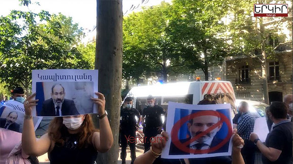 Pashinyan was greeted by angry protesters in Paris